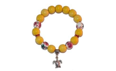 Karkötő, sárga, színesen díszített, teknős medál