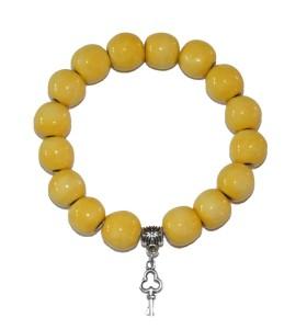 Karkötő, sárga, kulcs medál