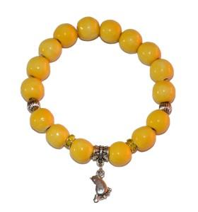 Karkötő, sárga, talpacska medál