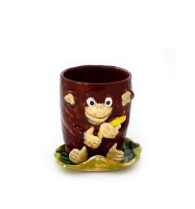 Csésze, csészealj állat, majom banánnal, barna